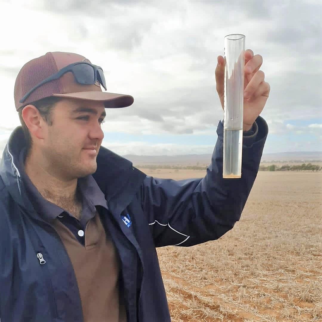 Hart intern, Declan Anderson, measuring rainfall in 2021