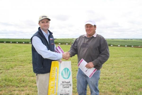 Colin Edmonson, LongReach congratulates Shawn Rayson, Princess Royal Station, Burra on winning 1t certified Scout wheat seed
